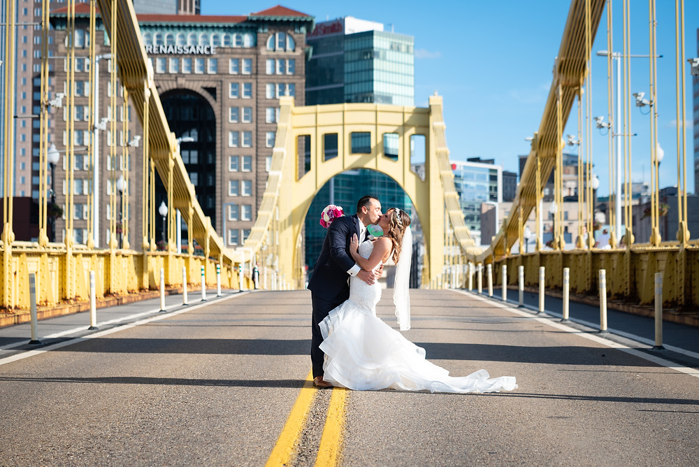 Bride and groom portrait on the Roberto Clemente bridge in Pittsburgh