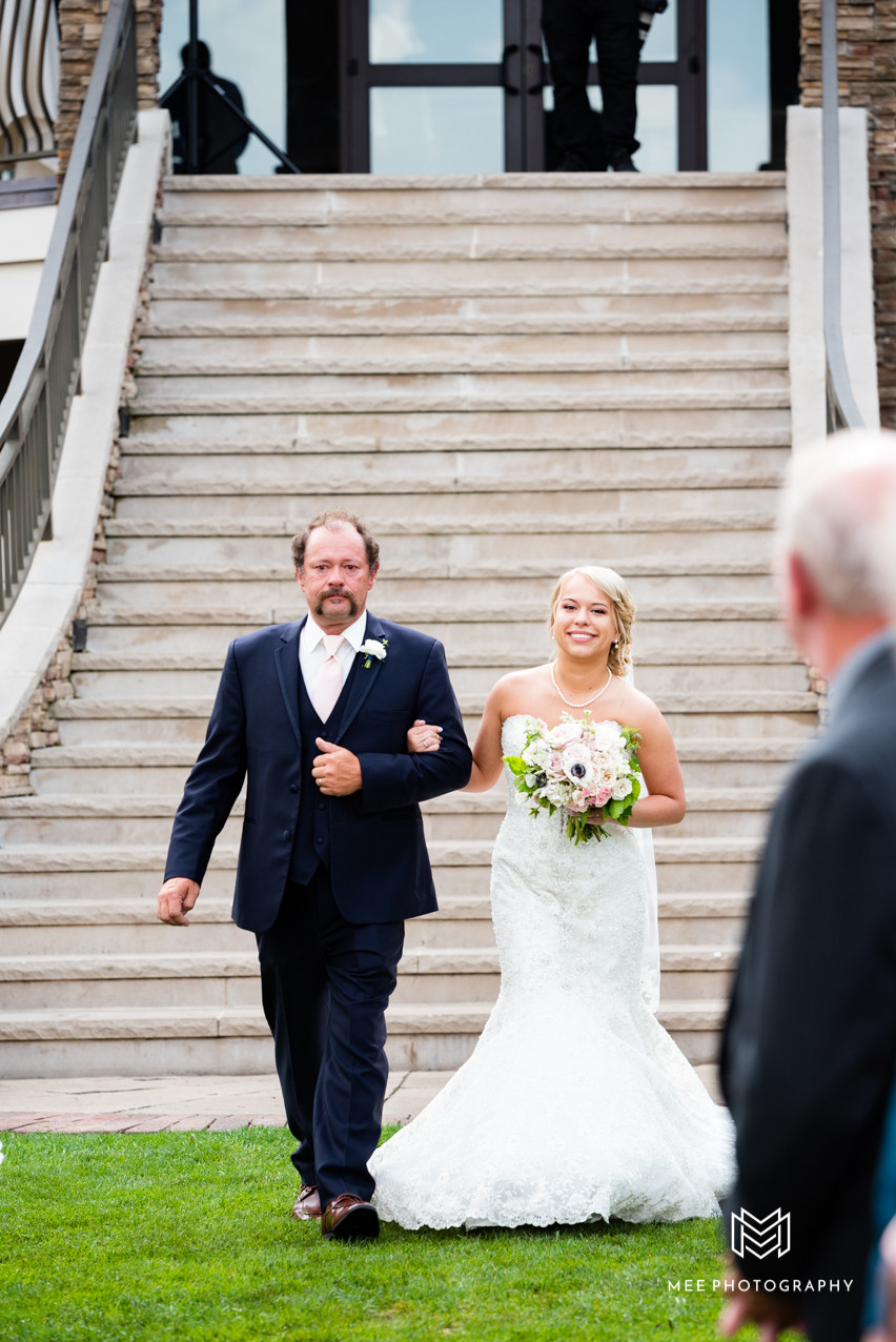 Bride walking down staircase with her Dad