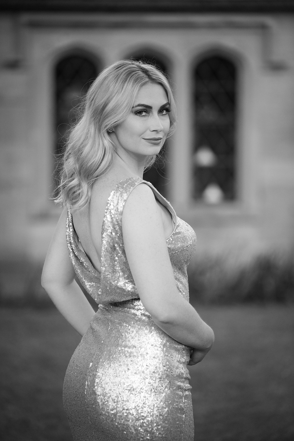 A black and white portrait of a women in a sequin gown during an engagement session at Hartwood Acres