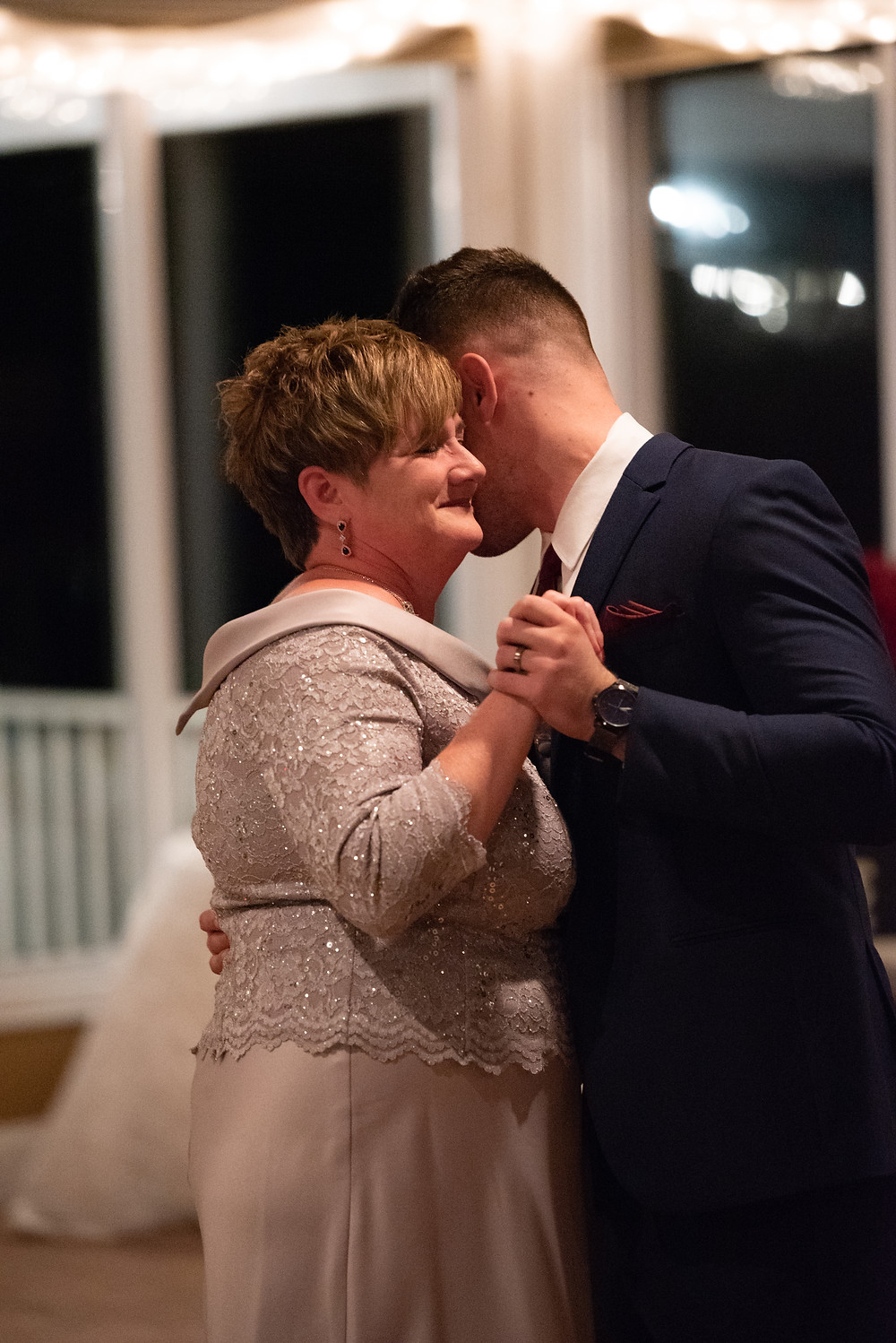 Mother and son dance during the wedding reception