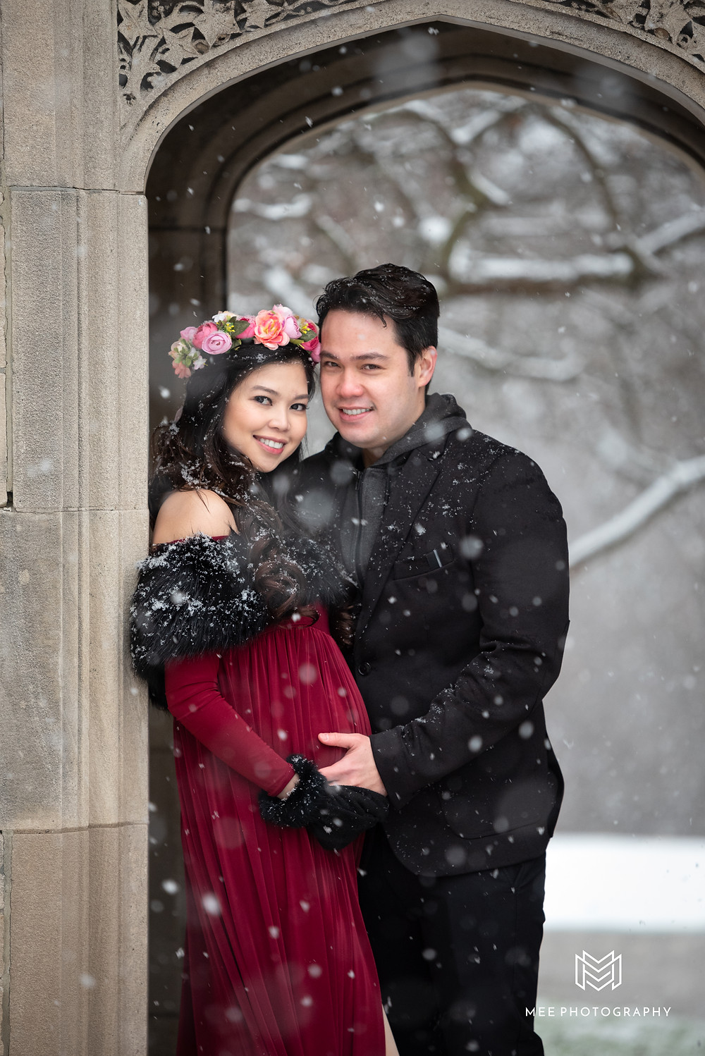Winter maternity photoshoot ideas in red dress and flower crown