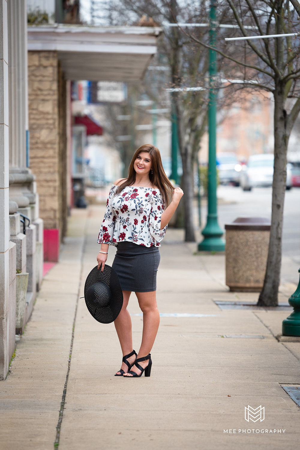 East Liverpool senior session with girl wearing a white blouse, gray skirt, and black heels.