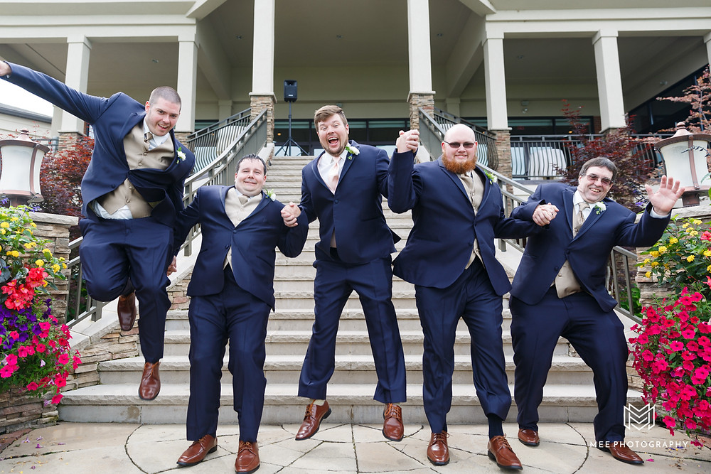 Groomsmen jumping for a photo at the Lake Club in Ohio