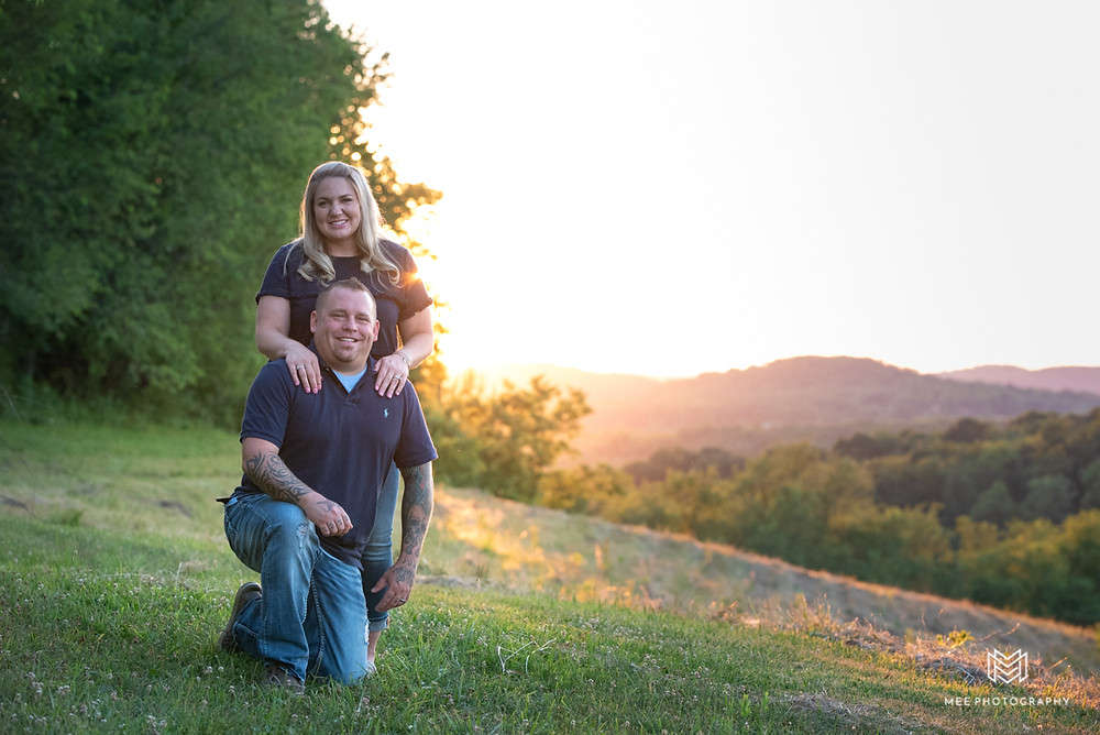 Portrait of parents at sunset with the rolling hills of West Virginia in the background
