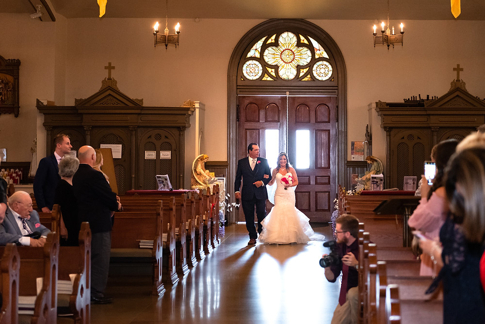 Father walking his daughter down the aisle at St. Stanislaus Kostka