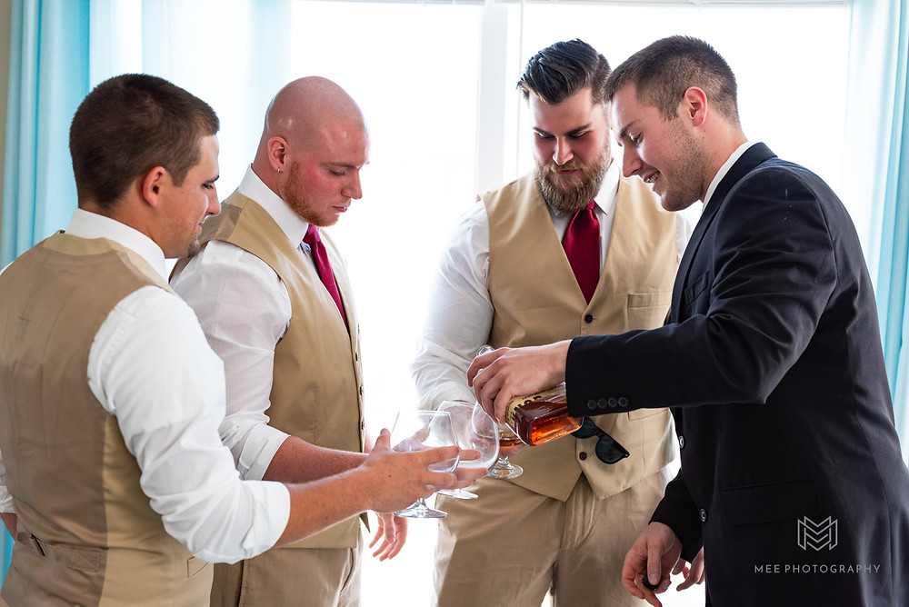 Groomsmen in khaki suits and Burgundy ties