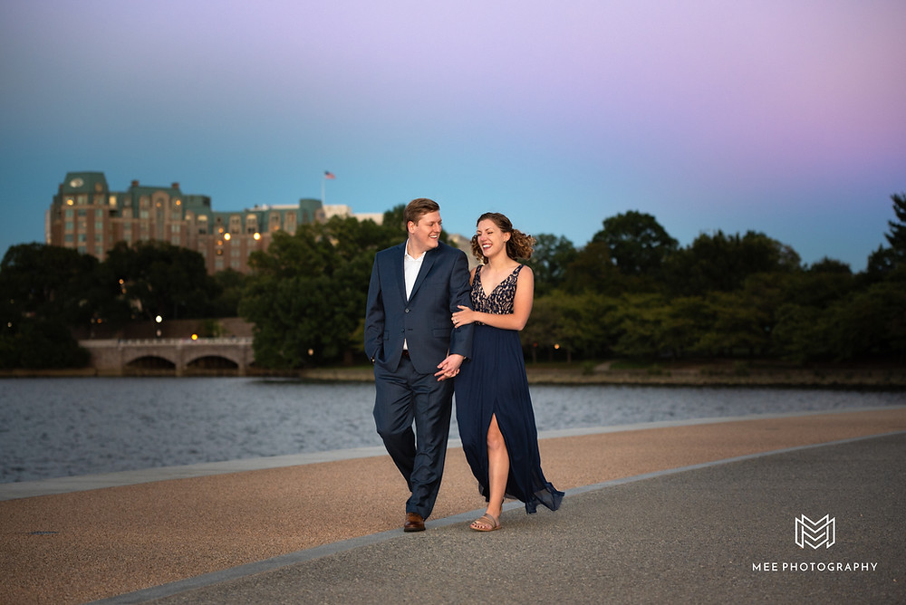District of Columbia engagement shoot at dusk with couple walking along the Tidal Basin
