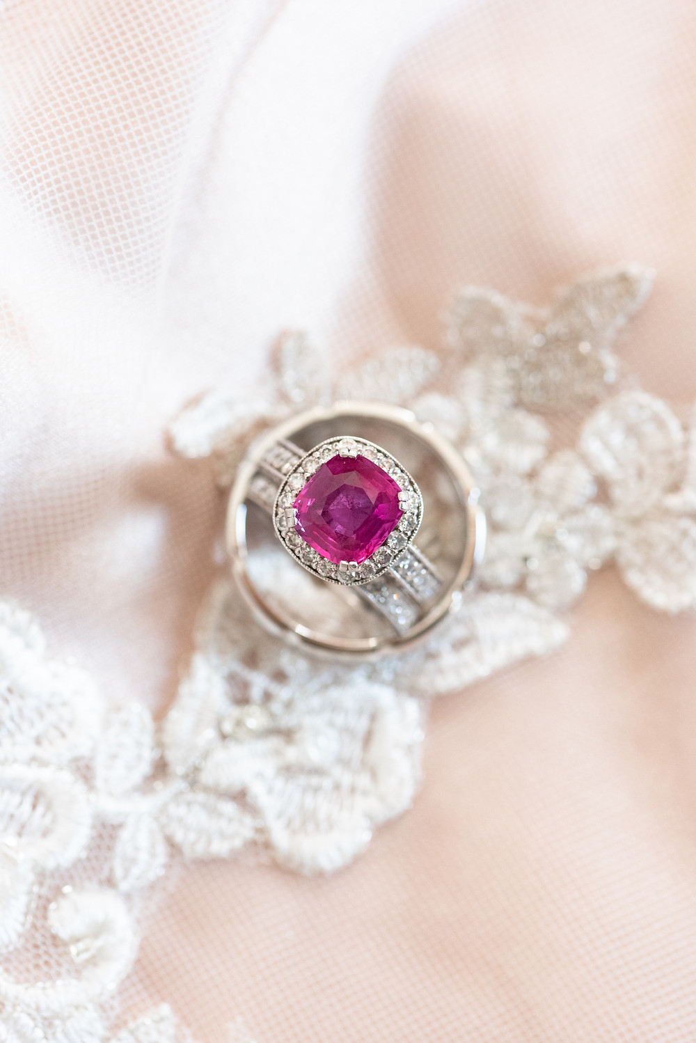 Four carat pink sapphire and diamond cushion cut engagement ring