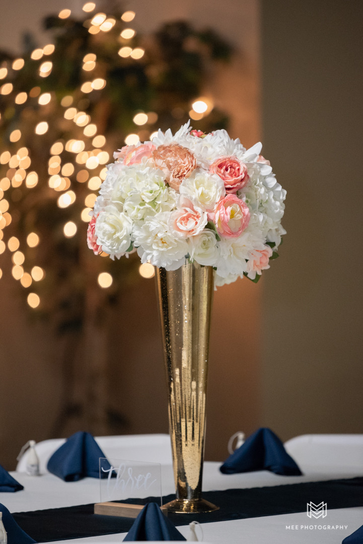 Tall gold wedding centerpieces with flowers