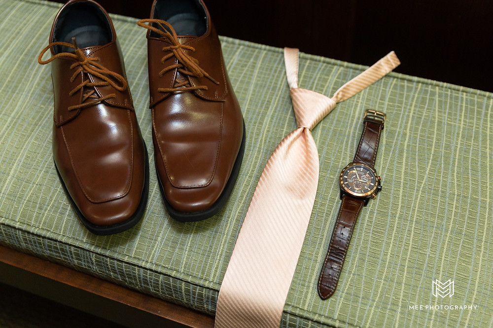 Groom's wedding details with brown shoes and blush tie