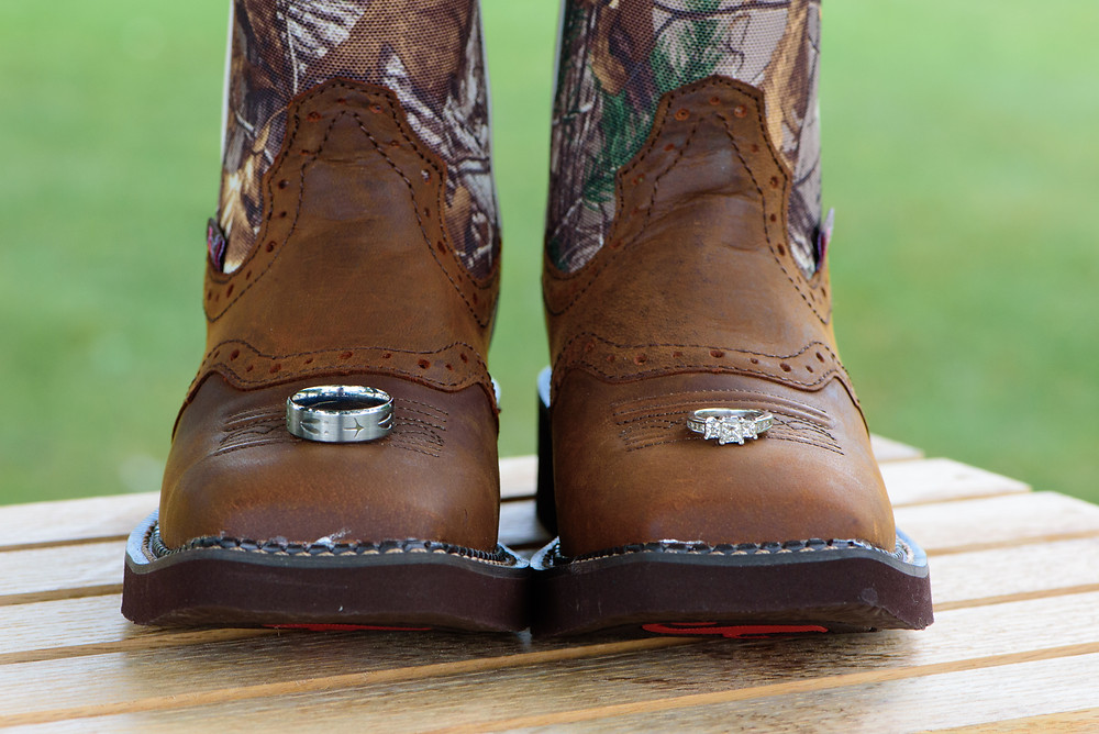 A photo of the wedding bands on the bride's boots that she wore for her wedding.