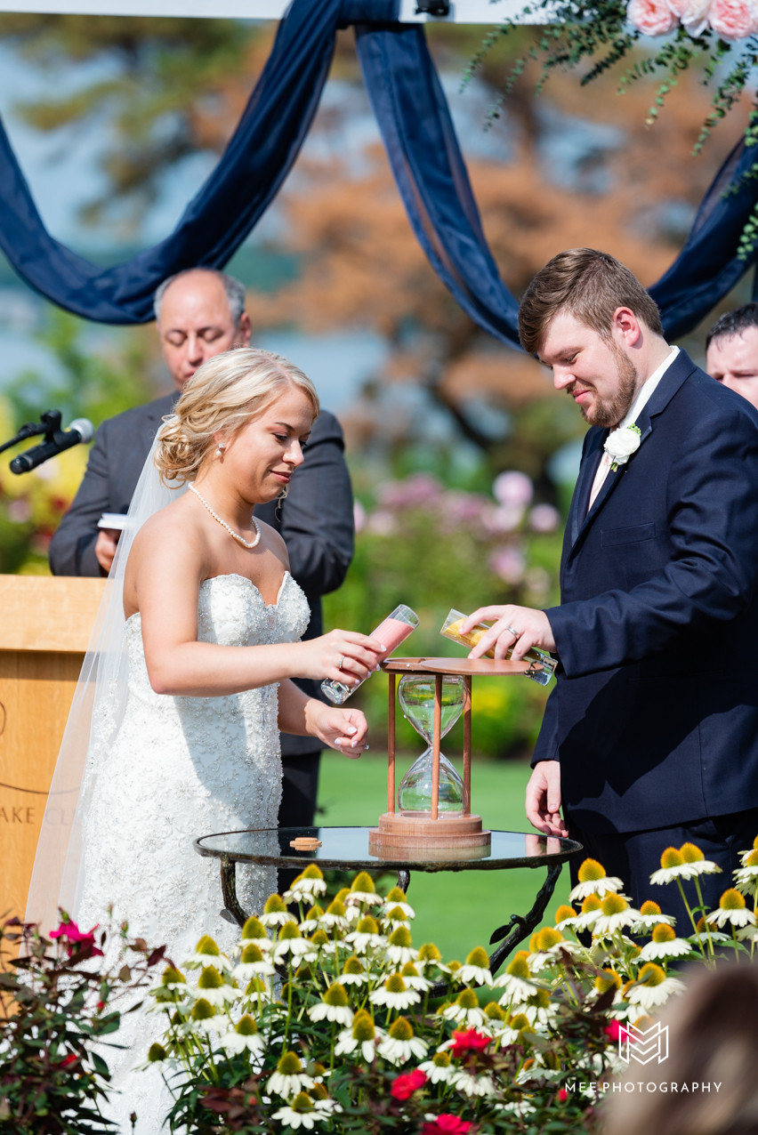 Bride and groom pouring sand into a hourglass