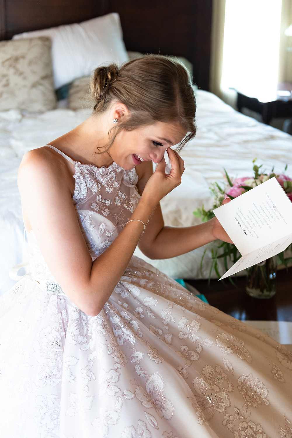 Bride crying while reading a letter from her fiance