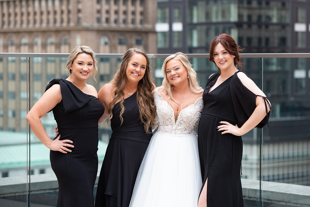 Bride and bridesmaid pose idea on the roof of Hotel Monaco in Pittsburgh
