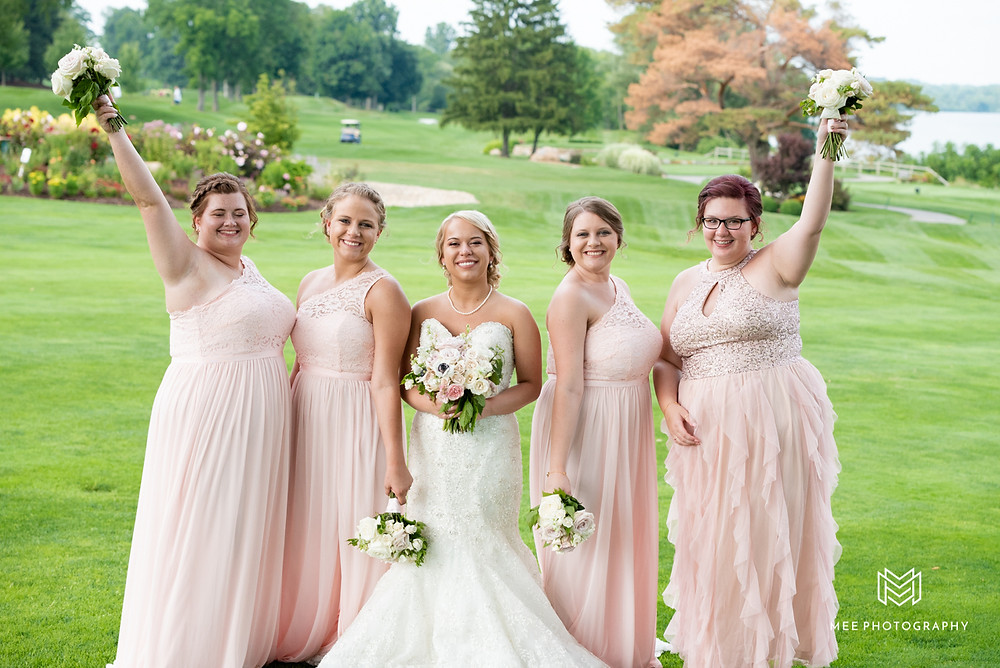 Bridal party photographs with the golf course in the background
