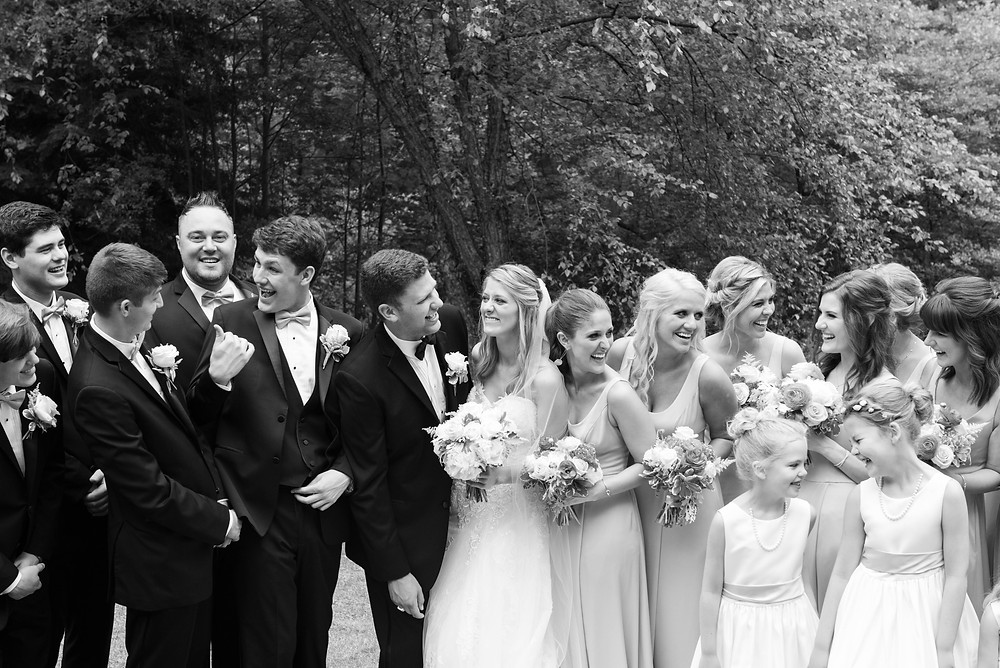 Black and white photo of large bridal party laughing in Ligonier, PA
