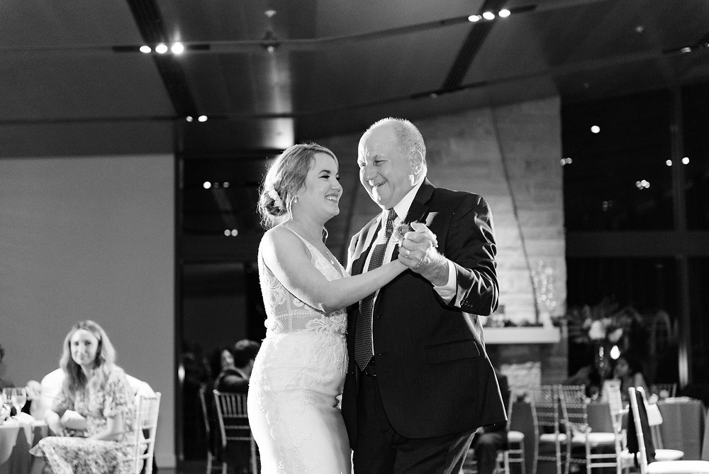 Family moments captured during wedding reception at The Aviary