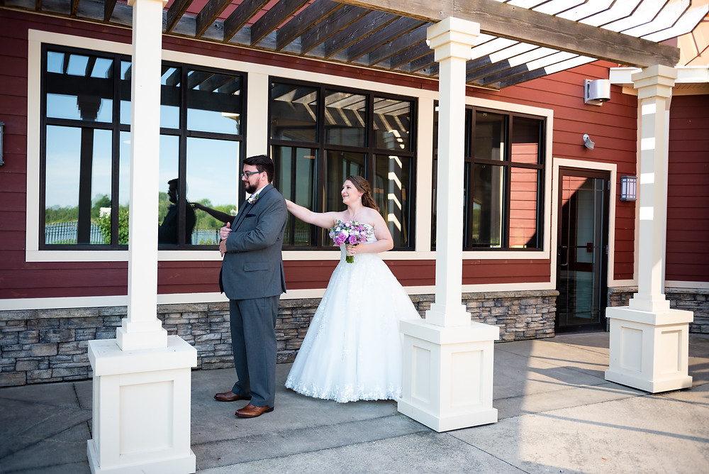 Bride and groom first look at Drake's Landing Banquet Center in Canfield, Ohio