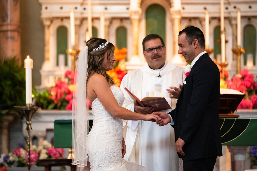 Exchanging of the rings at Wedding ceremony at St. Stanislaus Kostka in Pittsburgh