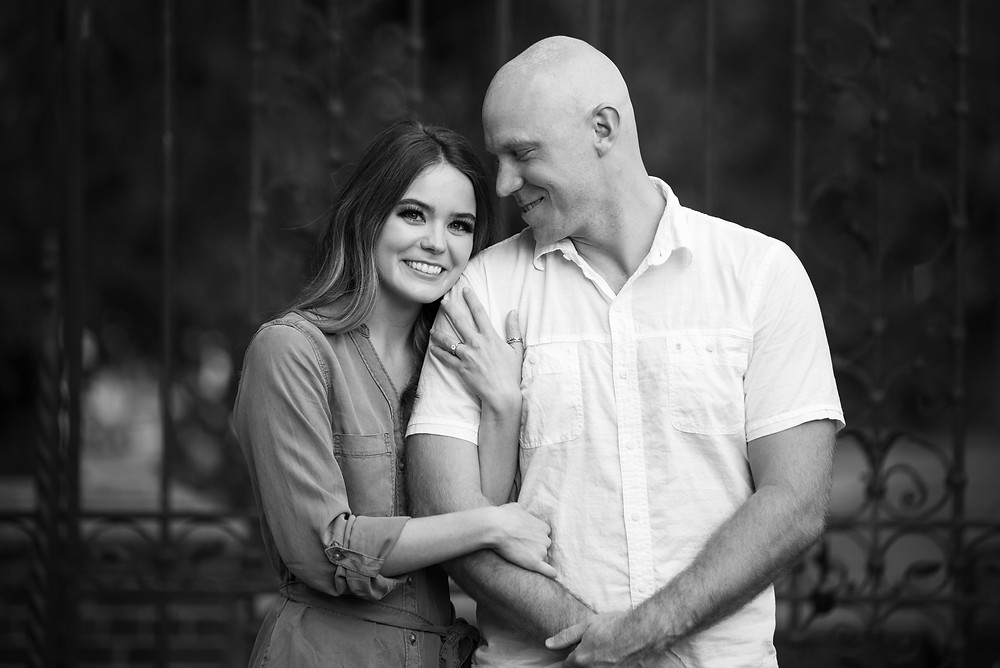 Black and white photograph of couple during their engagement session