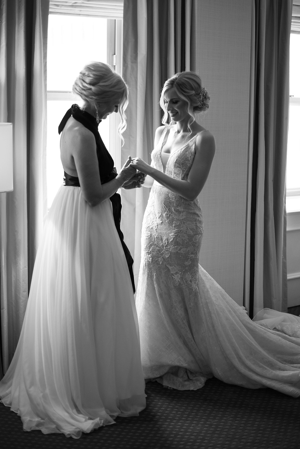 Mother seeing daughter in her wedding dress at the Omni WIlliam Penn Hotel