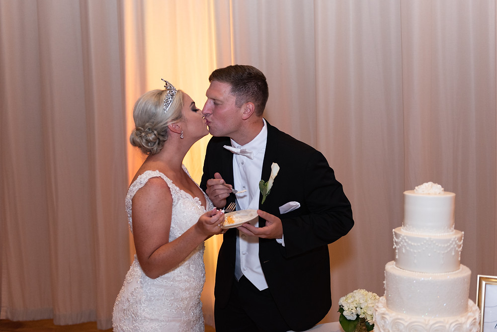 Bride and groom cut the cake at the Circuit Center