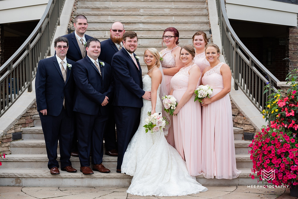 Bridal party wearing navy and blush