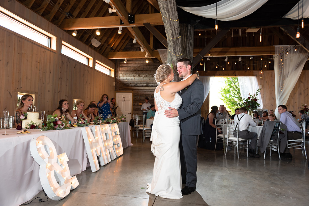 First dance as husband and wife inside the barn at Rich Farms Nursery