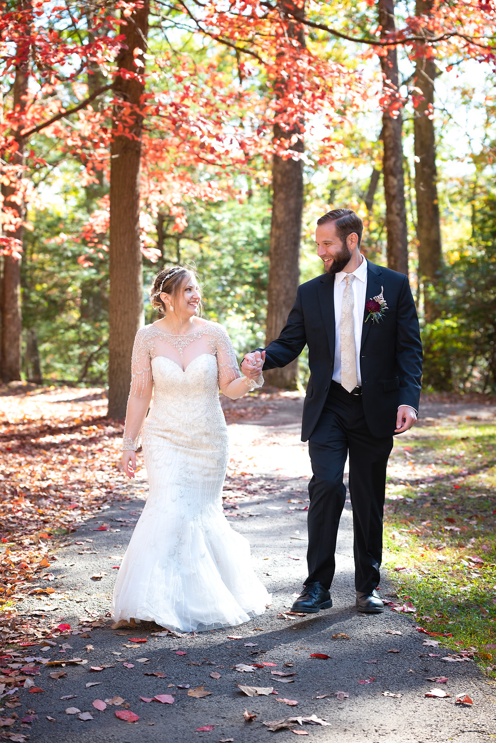 Bride and groom portraits in the woods; Walking and holding hands