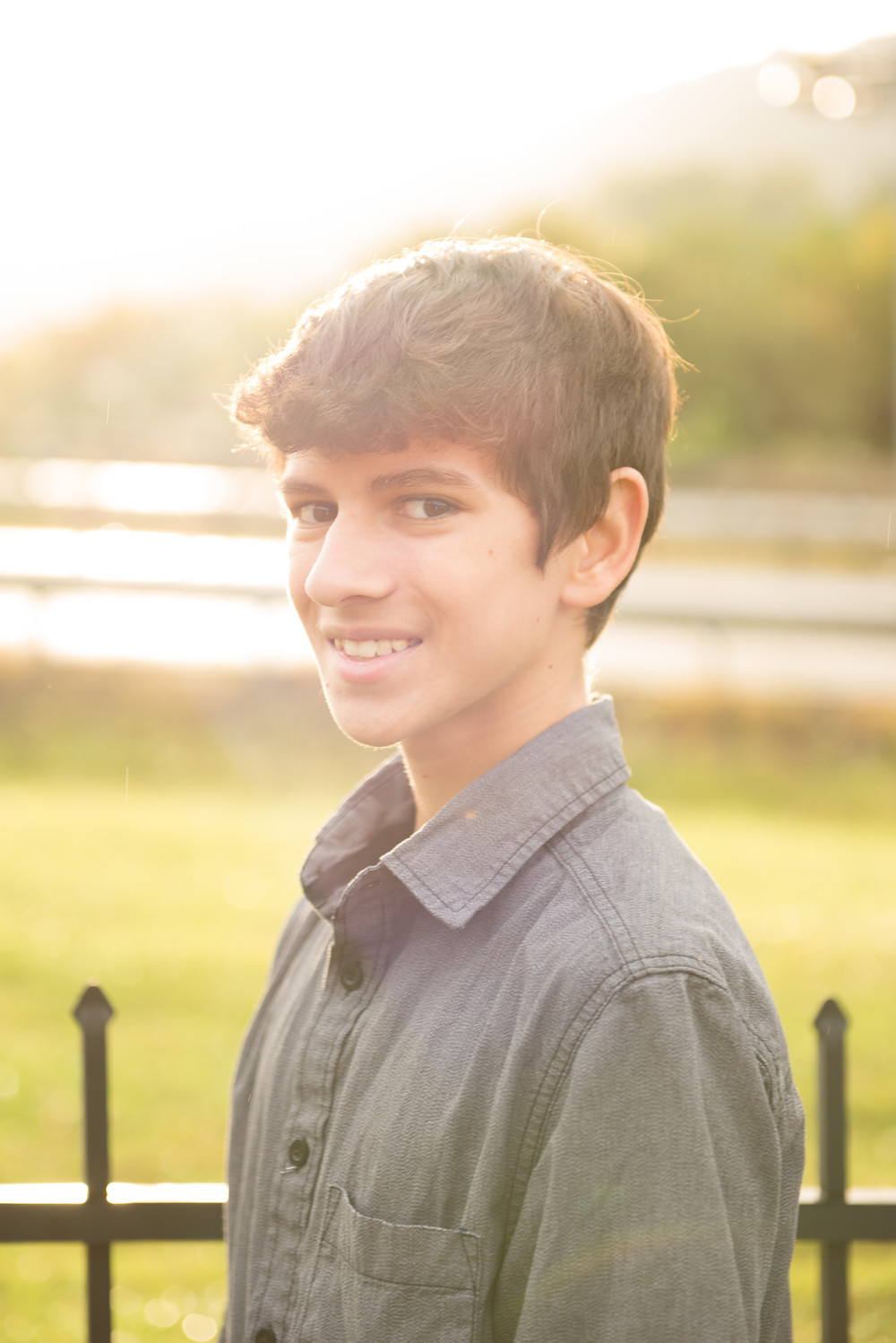 A high school senior portrait in bright sunlight during his photoshoot near Pittsburgh.