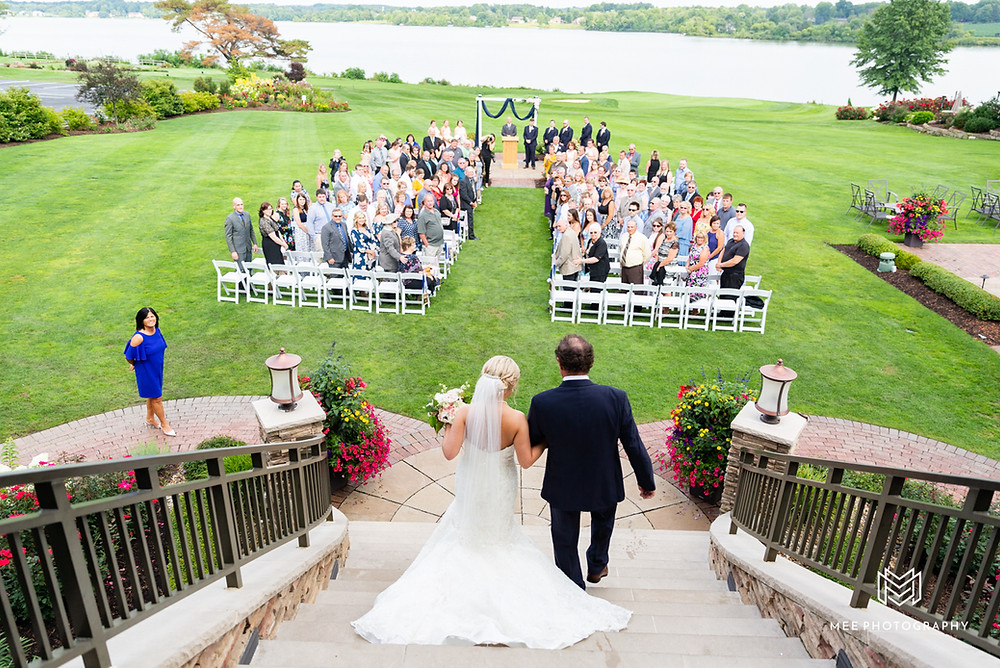 Bride walking down the stairs of the aisle with her dad at The Lake Club in Ohio