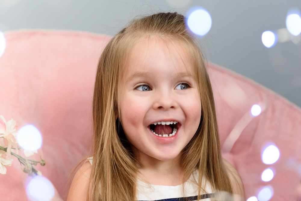 Picture of a surprised little girl during her photo session near Pittsburgh.