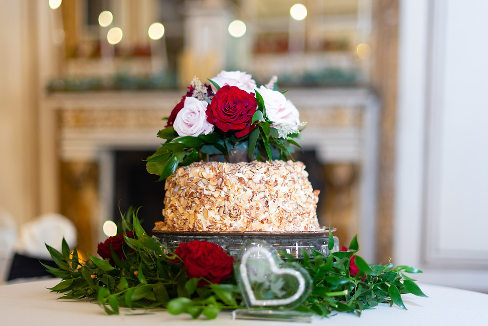 Almond wedding cake with roses on top