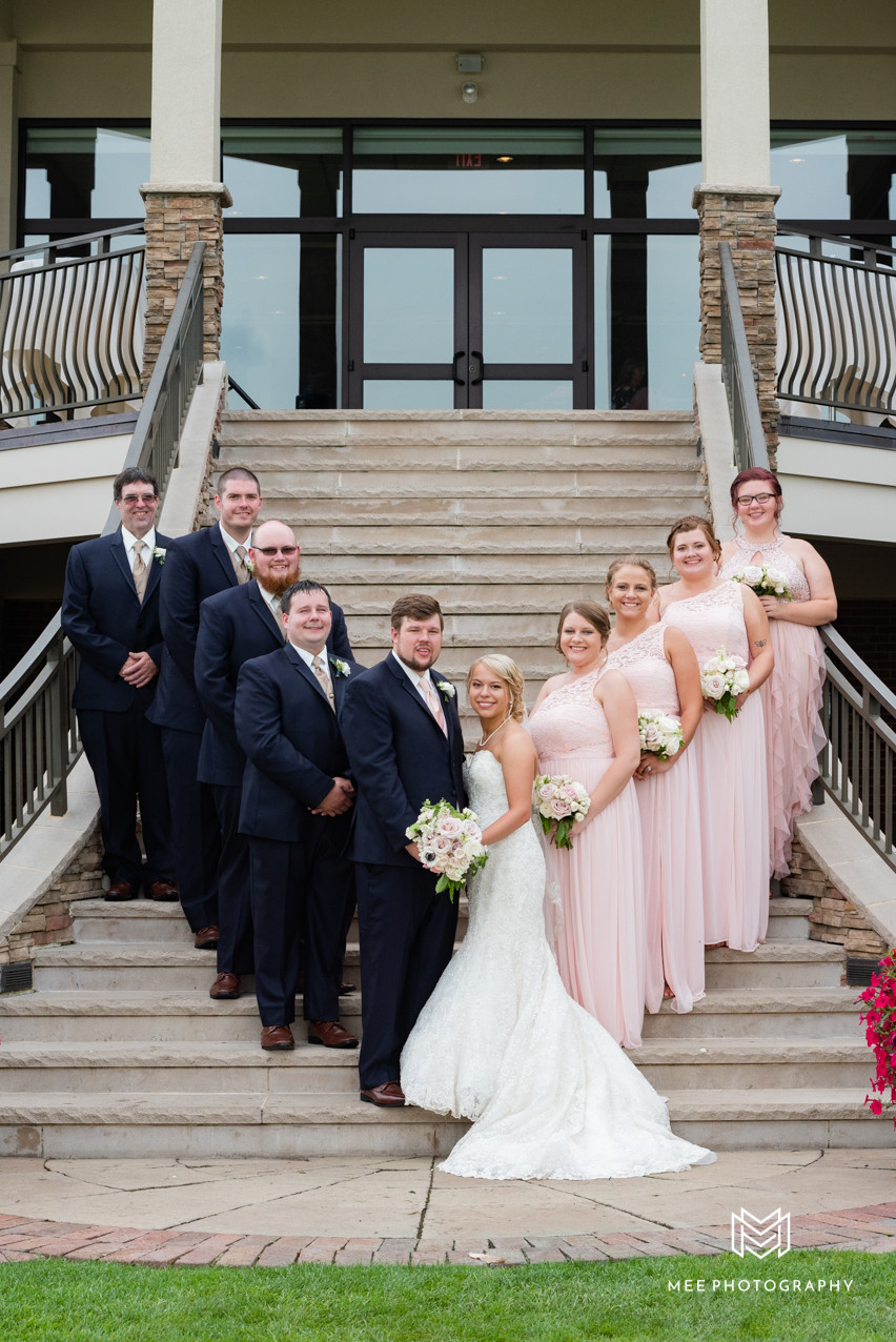 Bridal party posed on the stairs of the lake club i Poland, OH