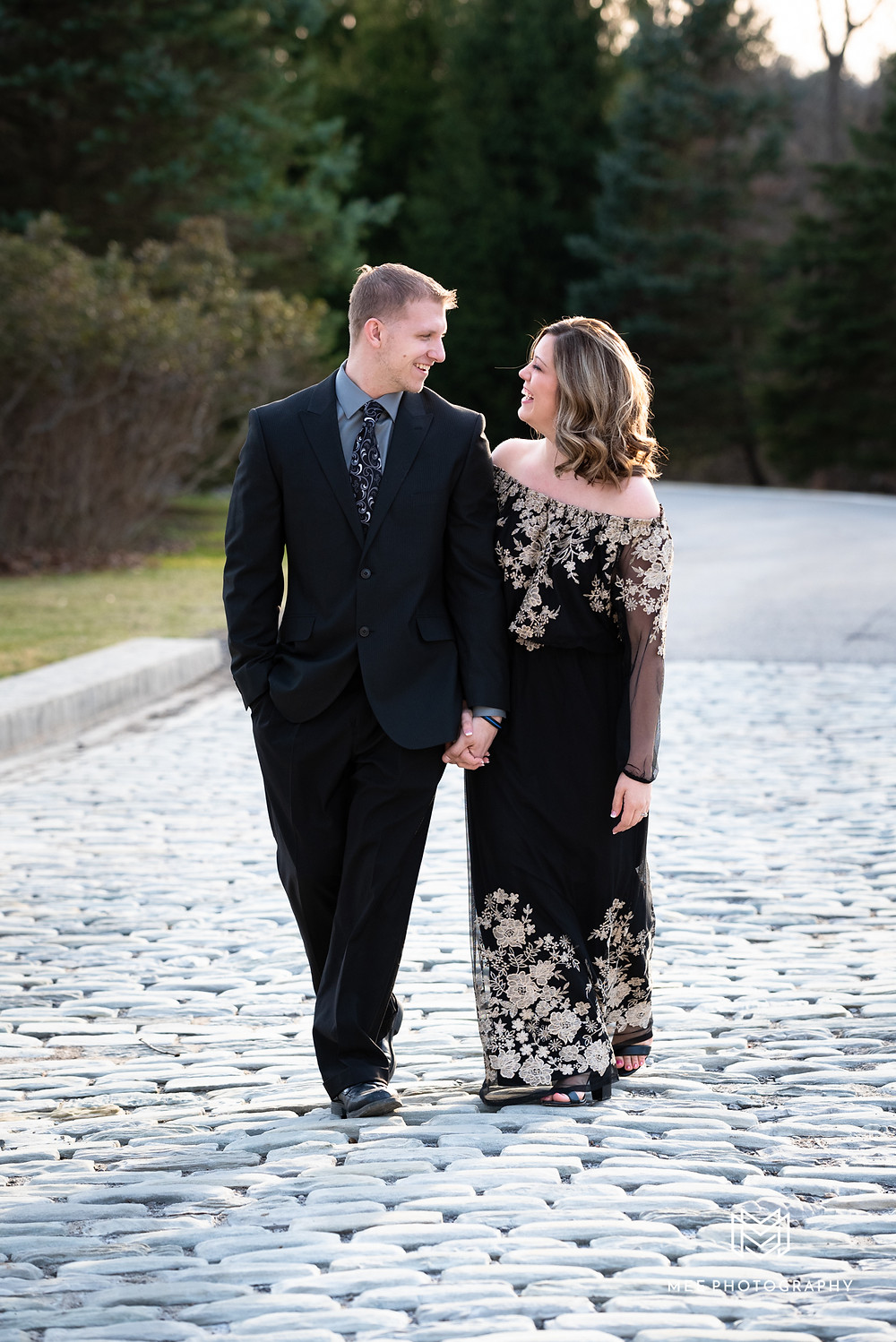 Couple walking and laughing at Harwood Acres Mansion