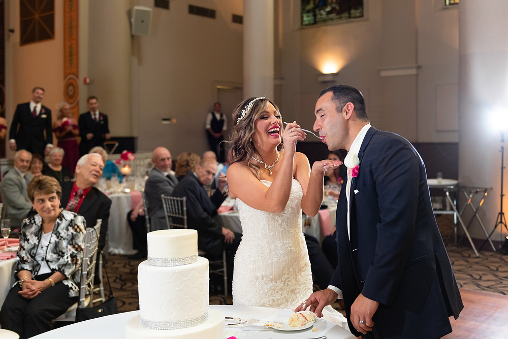 Bride and groom cutting the cake at The Priory