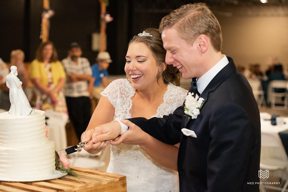 Cutting the cake as newlyweds