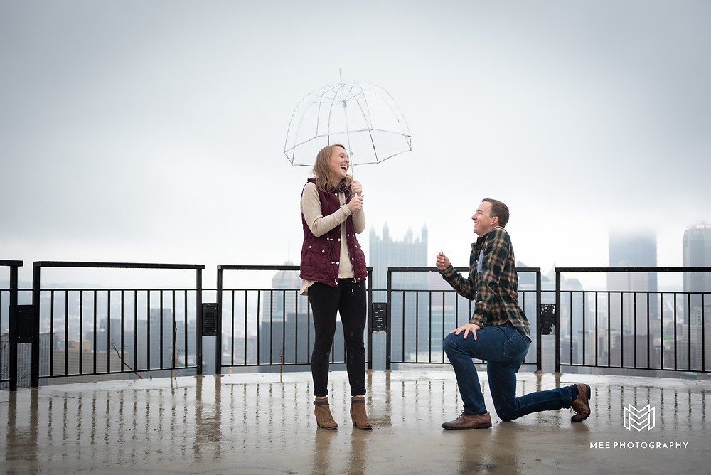 Surprise proposal on the Mount Washington Overlook in the rain
