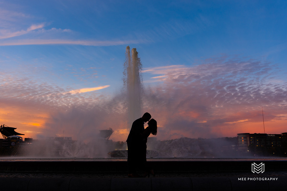 Engagement photo couple's silhouette at the Point State Park fountain