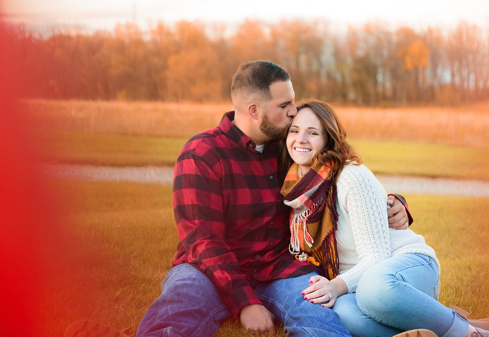 A fall engagement shoot with forehead kisses.