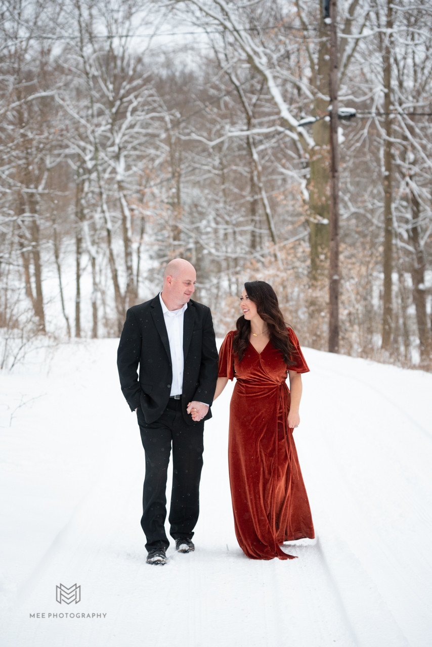couple walking and laughing in the snow
