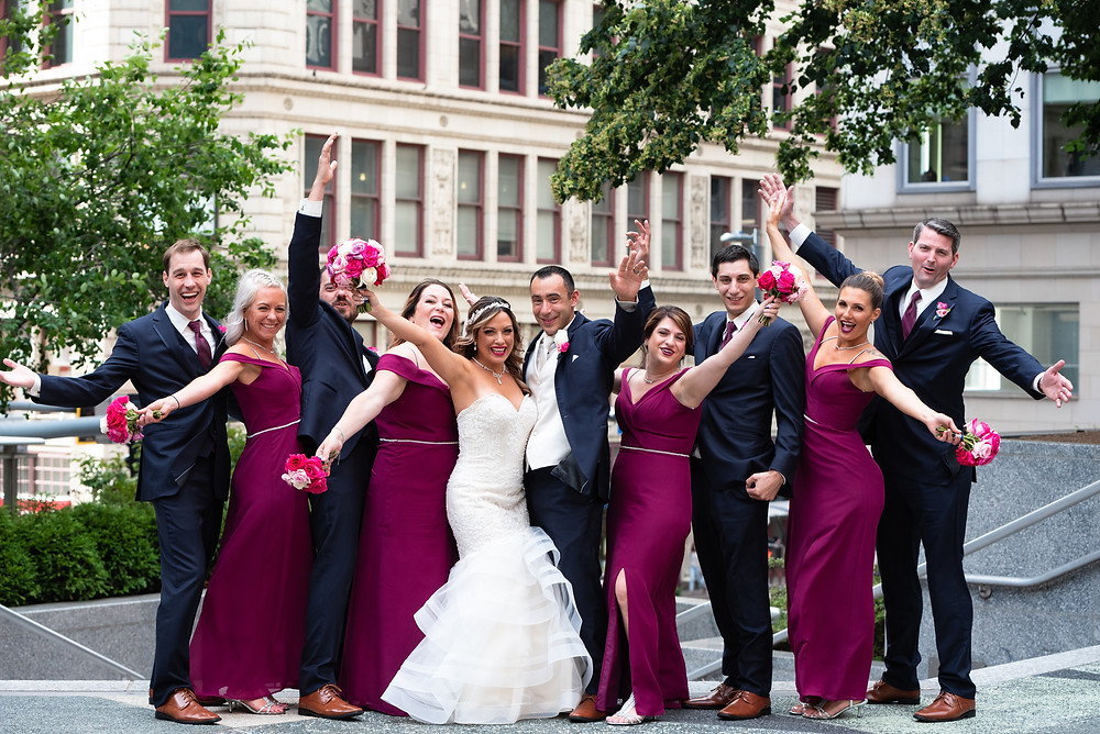 Burgundy and navy bridal party celebrating at Mellon Square in Pittsburgh, PA