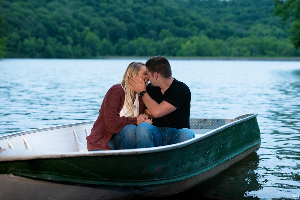 Couple sitting in a boat on the lake at Raccoon Creek State Park