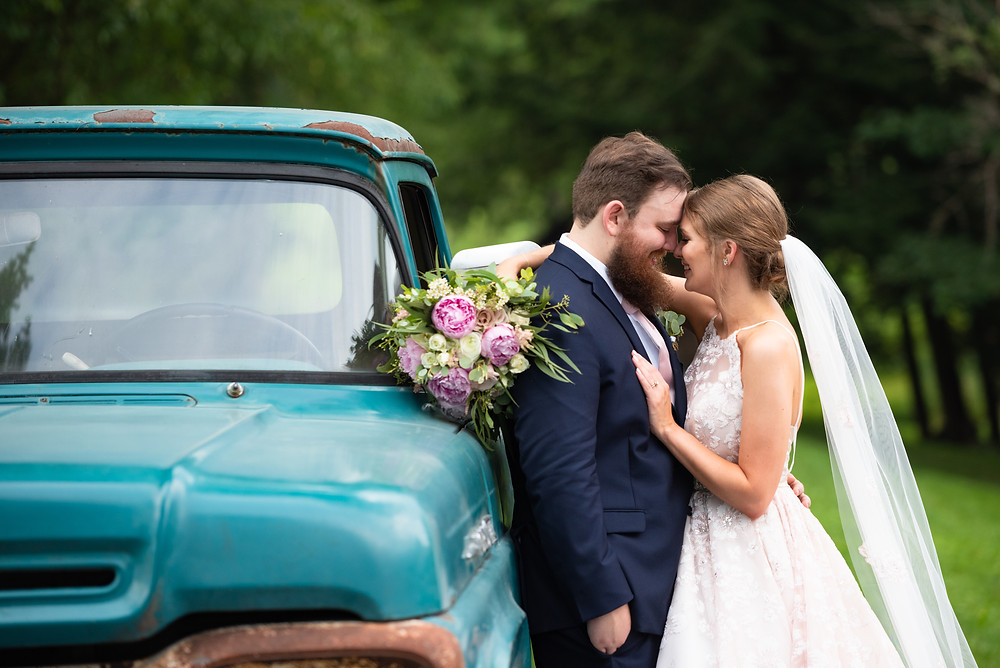 Bride and groom portrait with a truck