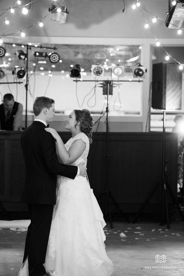 Black and white photograph of the bride and groom's first dance as husband and wife