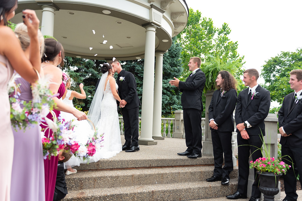 Bride and groom kissing at the end of their ceremony in Beaver, PA