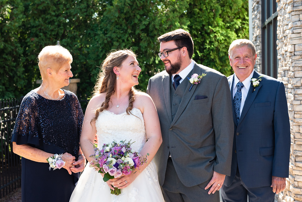 Family wedding portraits with the bride and groom's grandparents