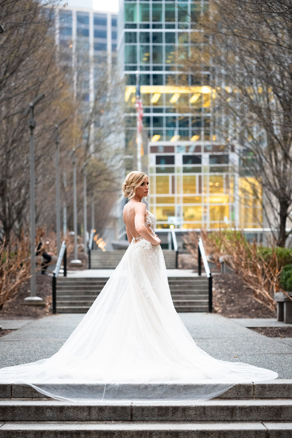 Bridal portraits in downtown Pittsburgh; Bride in Berta dress  with overskirt
