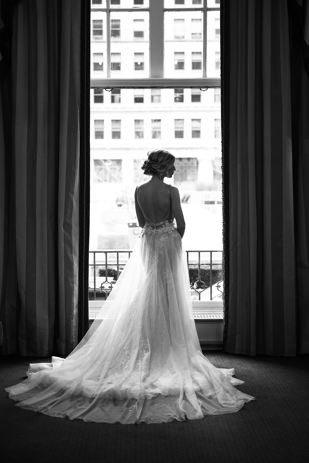 Bridal portrait in the window at the Omni William Penn Hotel in Pittsburgh