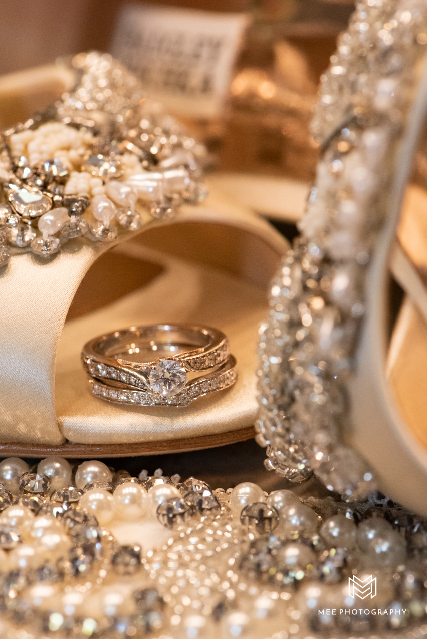 Wedding details of the rings amd shoes